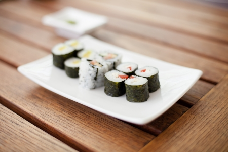 Plate of sushi rolls on a wooden table Stock Photo - 19900324