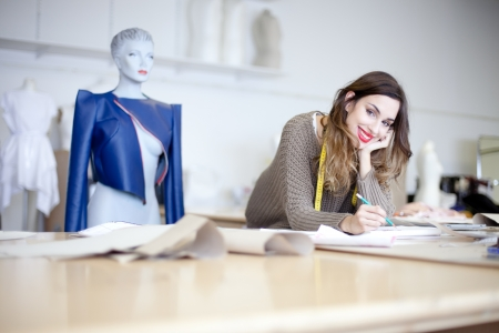 Fashion designer working on designs in the studio Stock Photo