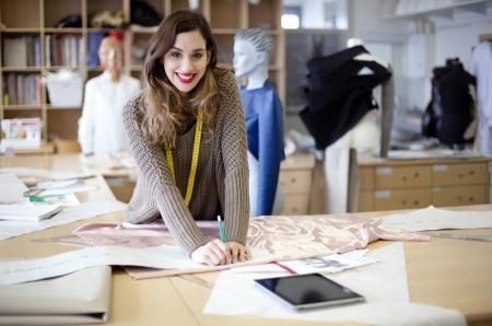 working dress: Fashion designer working in the studio