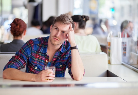 Pensive drunk man in a bar Stock Photo - 20509029