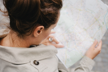 urban planning: Woman looking at city map on a trip  Looking for directions  Stock Photo