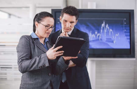 Businesswoman explaining future business plans to her colleague using tablet computer photo