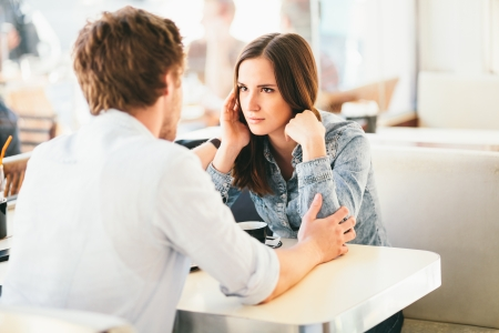 up to date: Couple fighting young woman about to cry