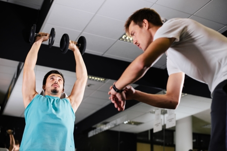 Gym buddies working out timing exercise photo