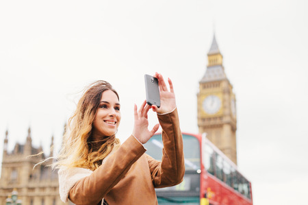 Female turist taking pictures in London Stock Photo
