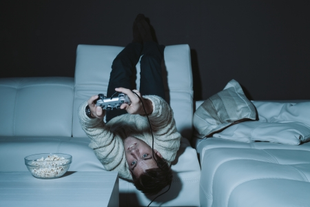 obsessed: Obsessed gamer playing a video game