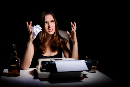 authors: Frustrated young writer having writer