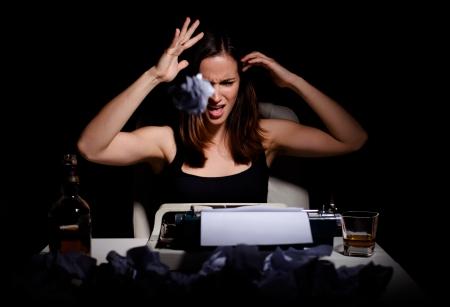 novelist: Novelist throwing wrinkled paper because of writer