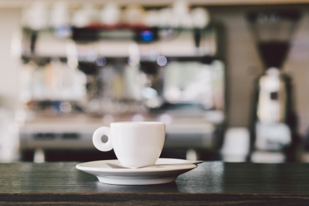 coffee maker: A cup of espresso coffee on bar counter