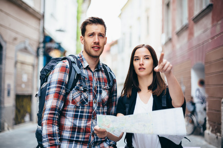 Couple of tourists looking at city map Stock Photo - 27639185