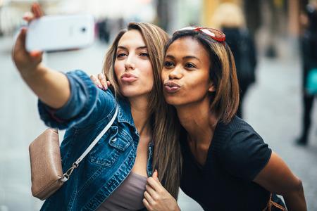 Friends taking a selfie on the street Stok Fotoğraf