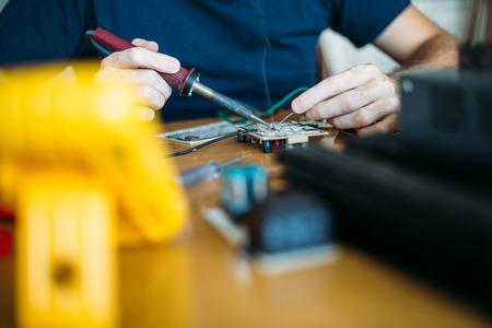 Electronics engineer reparing circuit board photo
