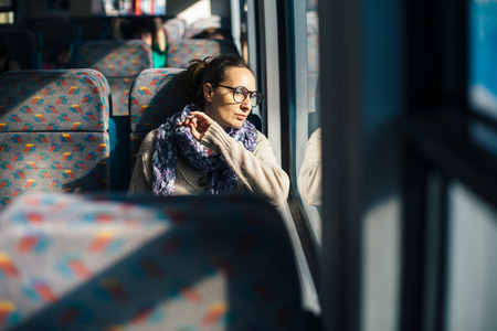 Pensive woman traveling by train bus photo