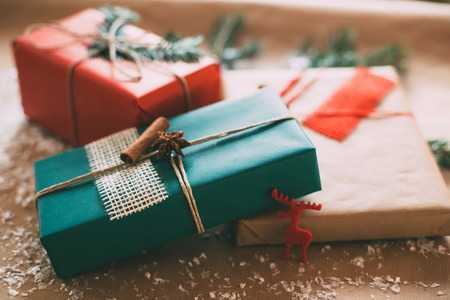 wrapped present: Classy Christamas gifts box presents on brown paper