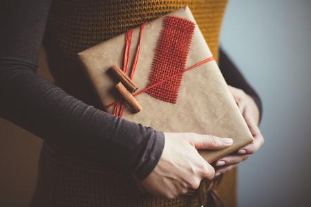 Woman holding modern Christmas present gift 版權商用圖片