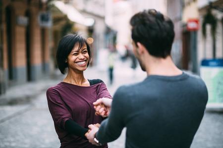 interracial love: Interracial couple in love having fun in the city