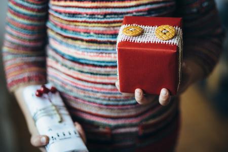 christmas presents: Little girl holding Christmas presents