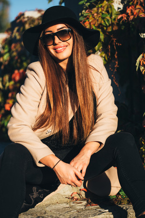 fashionable woman: Autumn portrait of hip cool fashionable woman Stock Photo