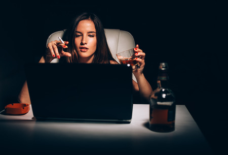 novelist: Female novelist smoking and drinking writing novel book
