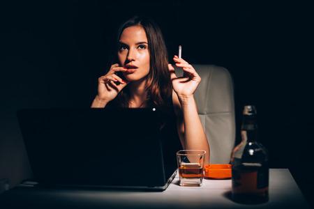 novelist: Female novelist smoking and drinking writing novel book