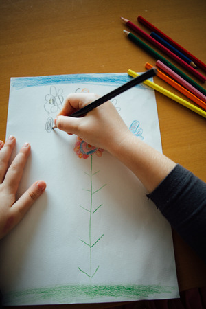 point of view: POV: Little girl drawing at home Stock Photo