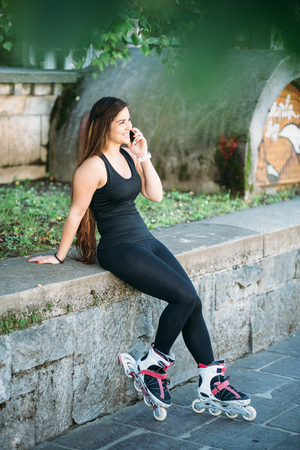 curvy woman: Young curvy woman texting on the street