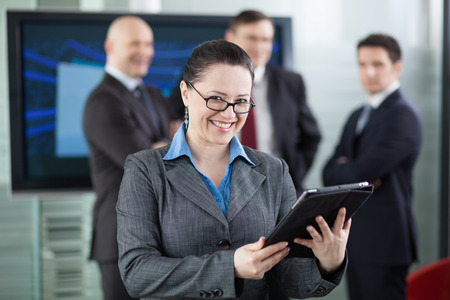 manager team: Businesswoman manager in front of her business team Stock Photo