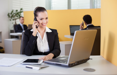 Businesswoman talking on the phone in the office photo