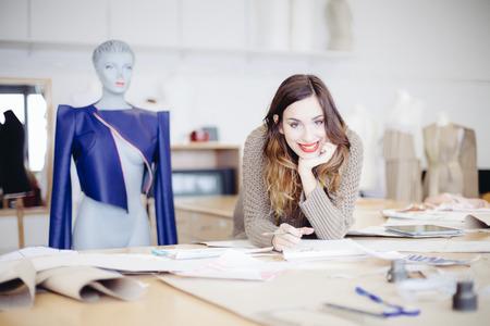 couture: Fashion designer working in her studio