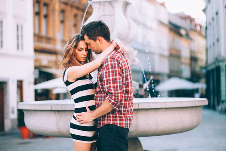 Millennial young couple embracing on street photo