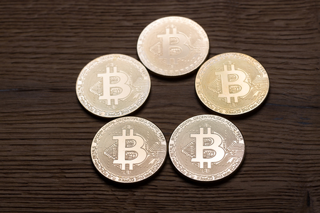 Physical bitcoin coins on wooden background Stock fotó