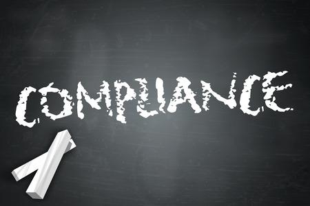 Blackboard with Compliance wording Stock Photo