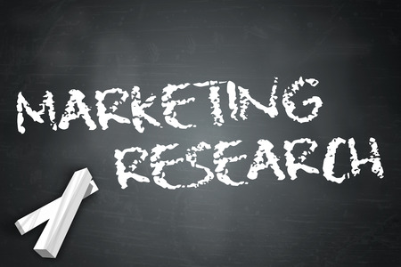 marketer: Blackboard with Marketing Research wording Stock Photo