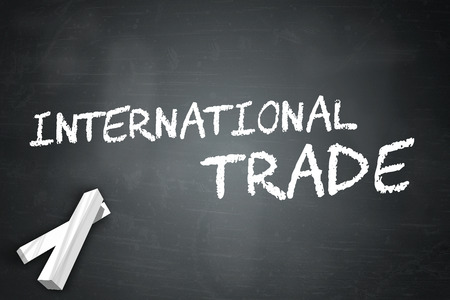 globalism: Blackboard with International Trade wording Stock Photo