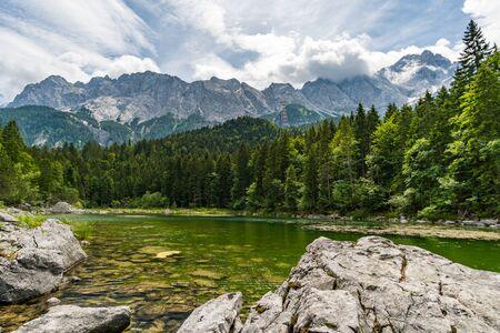 Fantastic round hike around the beautiful Eibsee at the Tiroler Zugspitze Arena Stock Photo