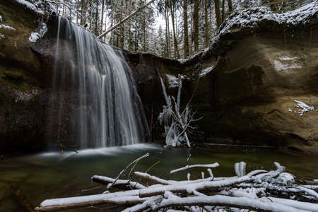 Hike through the snow-covered ravine at Schmalegg near Ravensburg in Upper Swabia