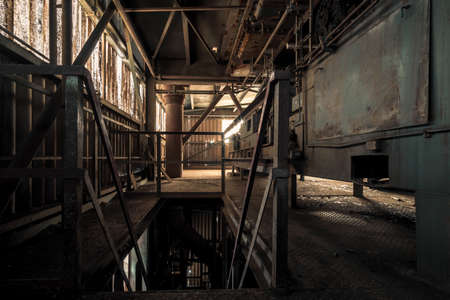 Creepy abandoned industry area with natural decay so-called lost place a decayed factory hall