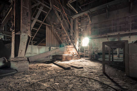 Creepy abandoned industry area with natural decay so-called lost place a decayed factory hall Stock fotó