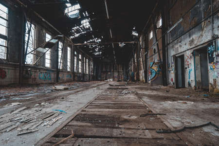An old abandoned industrial area, with lots of graffiti that is slowly falling apart Banque d'images