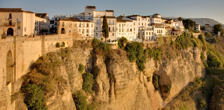 Many of Rondas buildings  are flush with the cliff of the river canyon walls. Stock Photo
