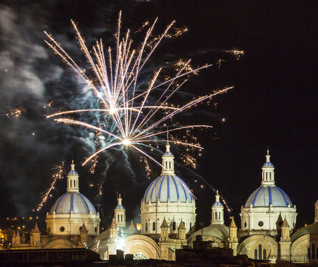 Fireworks over the domes of the New Cathedral in Cuenca, Ecuador. These are the famous view that are usually found on all travel brochures for the city. Stock Photo