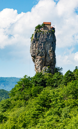 Katskhi Pillar is a single 120 foot tall towering pillar of rock with a small cell for a single monk at the top 版權商用圖片