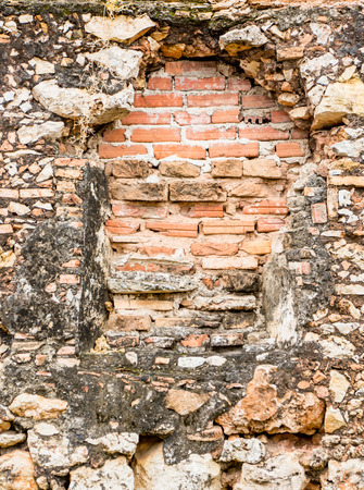Old door has been bricked over on poorly maintained wall in Trinidad, Cuba Stock Photo