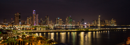Panama City skyline lit up at night with clear skies 스톡 콘텐츠
