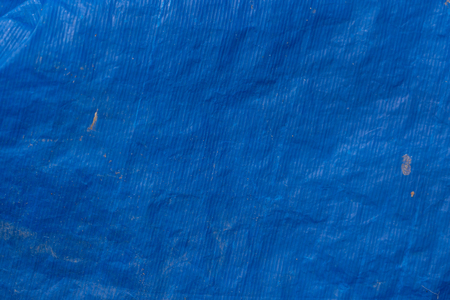 Background texture of blue plastic tarp
