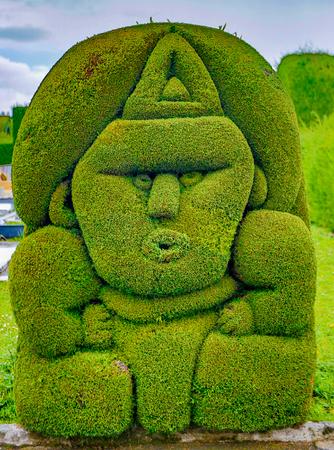 Tulum, Ecuador, Dec 11, 2017 - Exotic topiary created in Tulum cemetary in the North of Ecuador