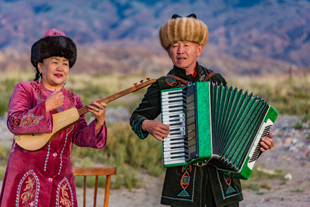 Issyk Kul, Kyrgyzstan - May 28, 2017: Musicians play traditional instruments
