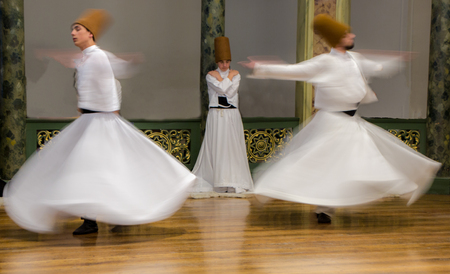 Blurred Whirling Dervishes practice their dance in Istanbul, Turkey on Apr 30, 2016
