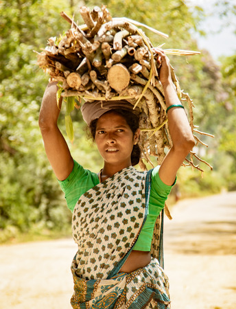 Mannar, India, Mar 8, 2018 - Woman carries her load on her head