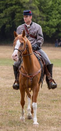 Man in Confederate uniform on horseback during Civil War Reenactment at Duncan Mills on July 14, 2014 Editorial
